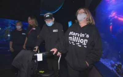 99-year-old man walks through Ripley's Aquarium to reach one million steps for fundraiser